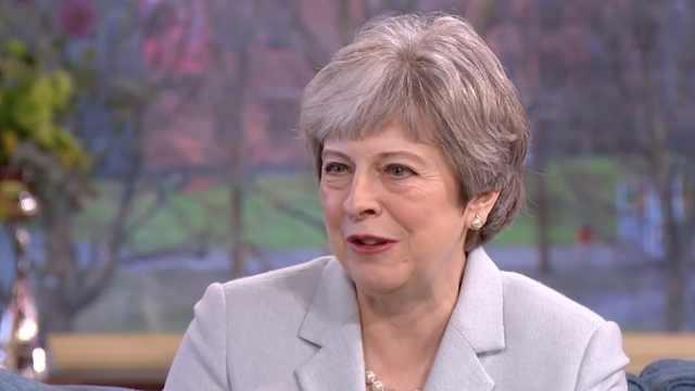 英首相受访:工作使我安全感满满