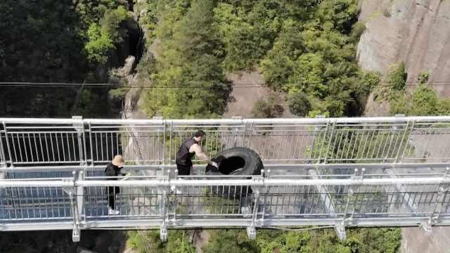 大力士玻璃桥上翻轮胎,单个400斤