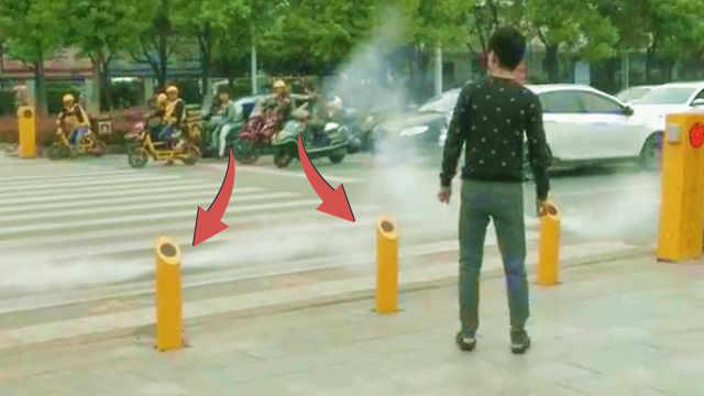 行人闯红灯就喷水雾,表示警告