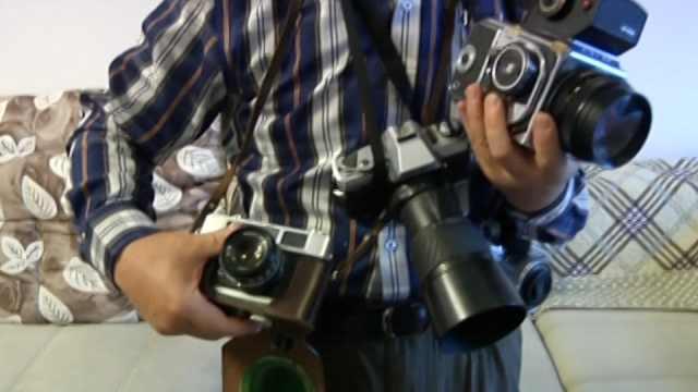 照相机记录美好生活和改革开放成绩