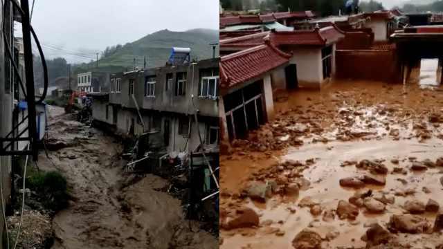 山洪倾泻村庄被淹,挖掘机转移村民