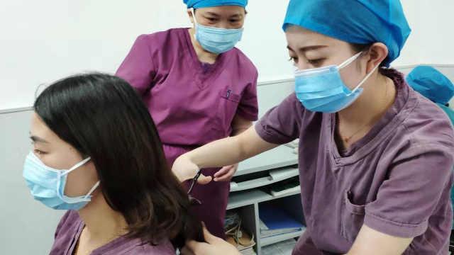 女医护自发剪掉长发:方便穿防护服