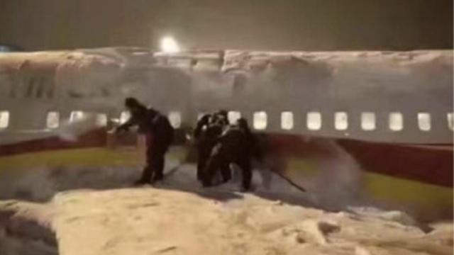 大雪埋飞机?你被航空公司玩了