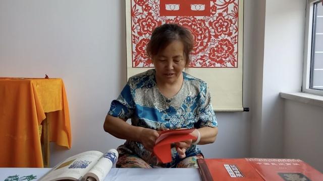 她剪纸56年,成红高粱剪纸插图作者