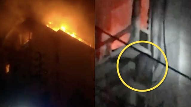 居民楼起火,小孩趴空调外机获救