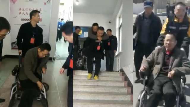 大叔坐轮椅自考,监考员背他进考场