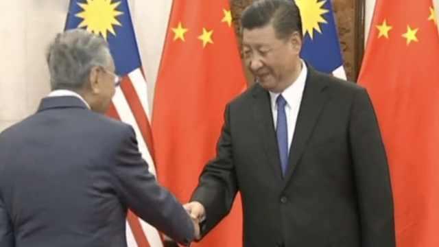 习近平会见马来西亚总理