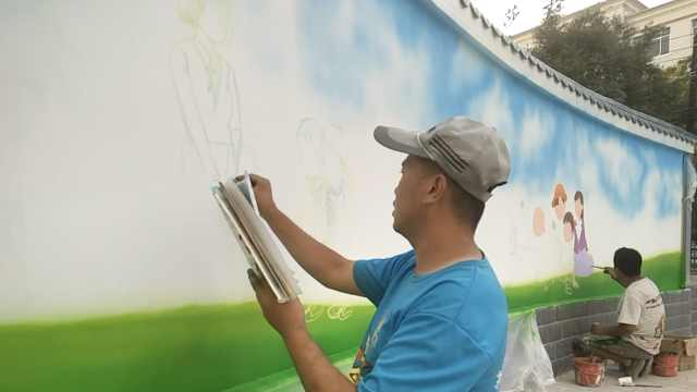他站8小时创作墙体画:随身带感冒药