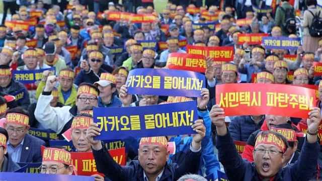 韩5万出租车司机游行,抵制拼车服务