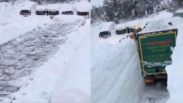 奥地利积雪有多深?没过卡车车顶!