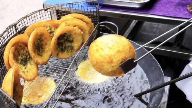 洋芋粑粑传承37年:小伙吃了长子弟