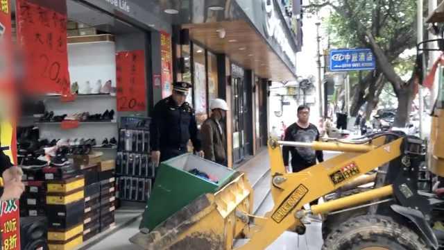 城管撤回水泥垃圾桶:教育效果很好