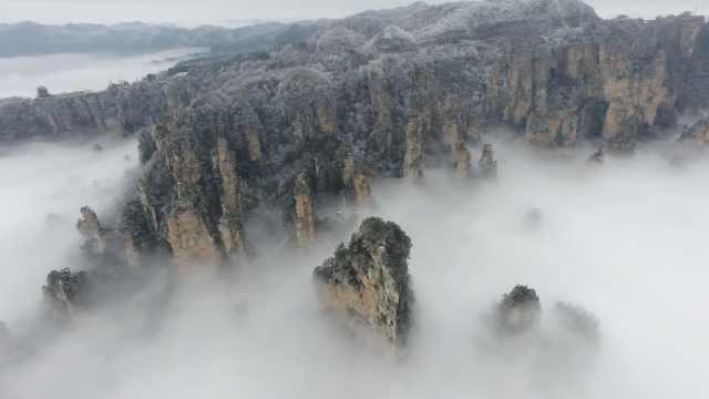 武陵源冰雪雾凇遇云海,美如山水画