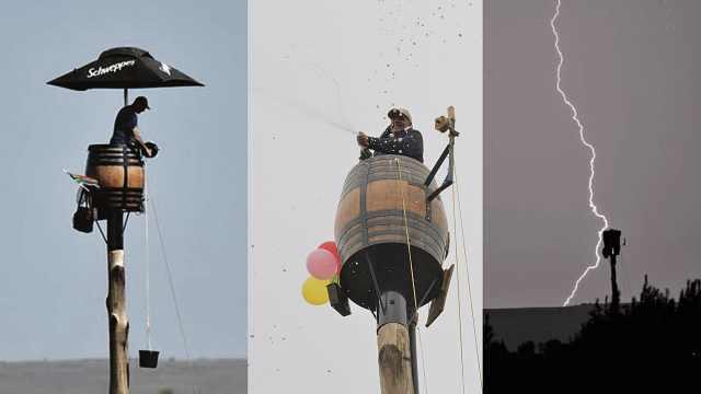 男子在离地25米高木桶内生活67天