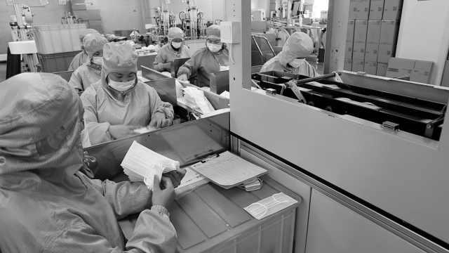 复工 企业24小时生产口罩防护服:境外订单不断