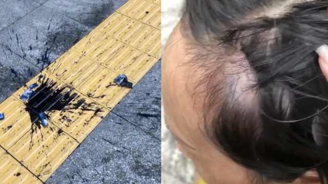 女子刚出门被墨水砸中头部,居民:还丢下来过