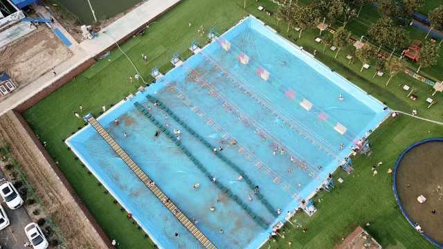 村书记花130万将垃圾坑建成水上乐园,村民可入股分红