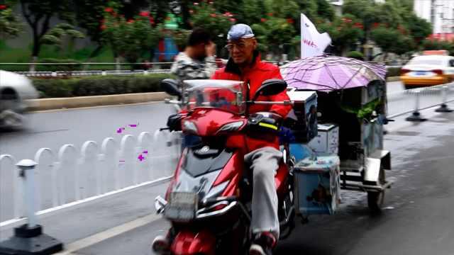 8千公里!70岁大爷骑电动车游8省2市,单手轻松拎起桶装水