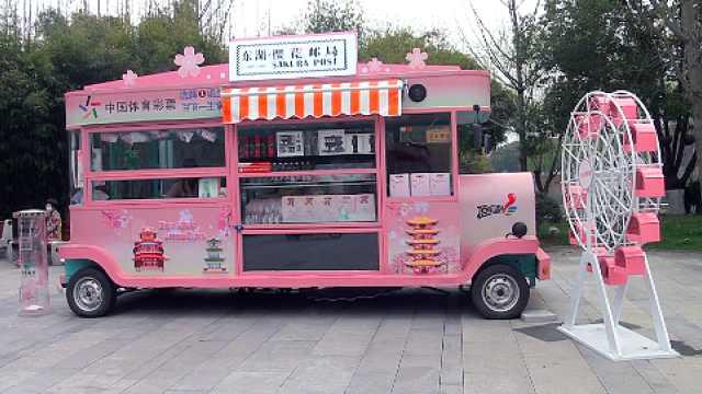 """武汉有个""""樱花邮局"""",邮戳都是粉色的"""