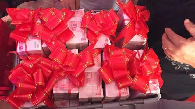结婚为啥送三斤三两的百元大钞?